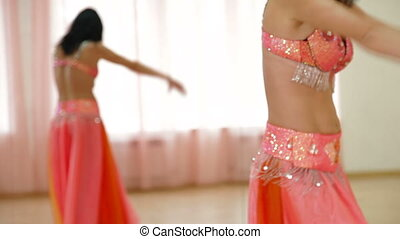 belly dance in front of mirror - woman performs belly dance...