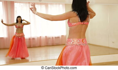 Belly Dancer Practicing in Dance Studio