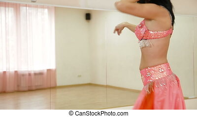 Belly Dancing Lessons - Woman perform belly dance at the...