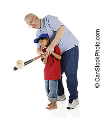Its a Hit! - A senior and his preschool grandson working...