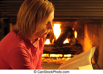 Woman Reading - A Mature Woman Reading A Book By Firelight...
