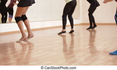 dance class - group of dancers practicing in dance studio