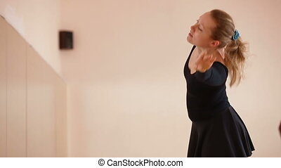 stretching - Woman stretching in Dance Studio