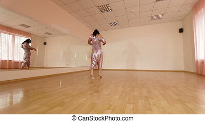 Dancing Woman - Woman practicing modern dance in front of...