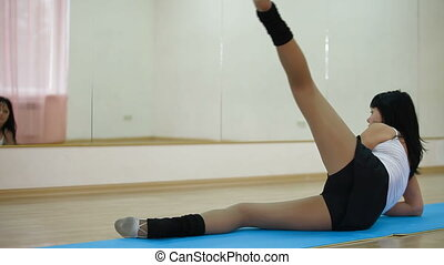 adult woman exercising in  fitness center