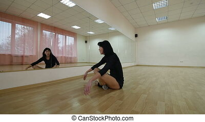 relax after dance - woman relaxing after dance classes in...