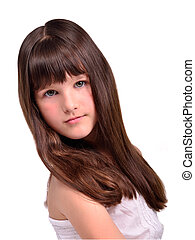 Portrait of beautiful little girl with luxuriant long hair -...