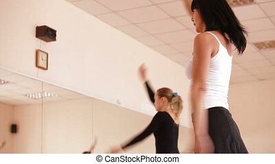 Fitness Dancing - Women with coach stretching in Dance...