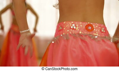 Orange belly dancer - Belly of the woman dancing in the...