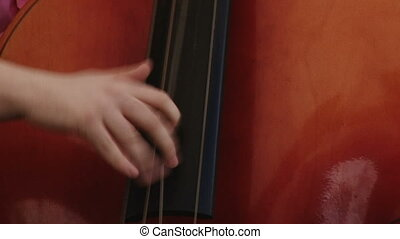 Man fast playing double bass, live concert, close up