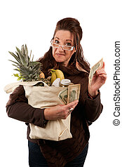 Smart Savvy Grocery Shopper - Middle aged female shopper...