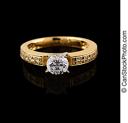 Gold ring with brilliant on black background - Gold ring...