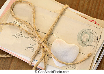 Stone heart with tied letters - Stone heart with old tied...