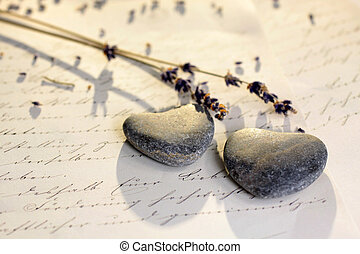 Stone hearts with old letter and lavender