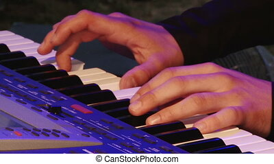 Man play music keyboard, colorful light