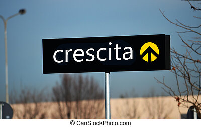 Street sign in Italian reading Growth - Growth on direction...