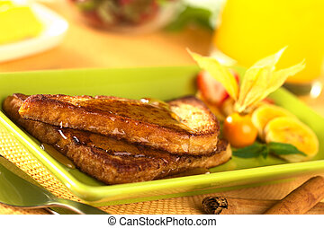 French toast with maple syrup and fruits (Selective Focus,...