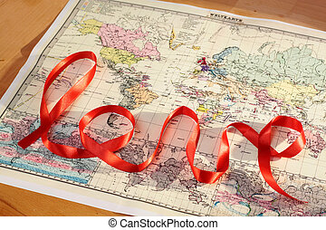 Lettering love - Red lettering love over historic world map