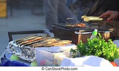 Grilling fish - Fish cooking on an on outdoor grill - BBQ
