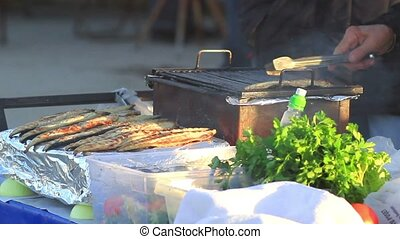 Cooking fish - Fish cooking on an on outdoor grill - BBQ