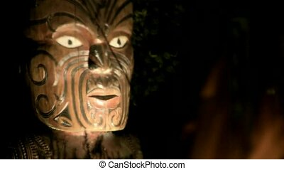 Maori Carving fire relection