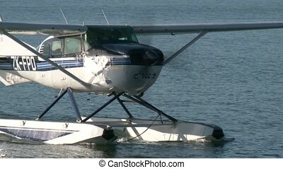 Float Plane landed - Floatplane coming into jetty
