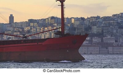 Red, large cargo ship - Side view of large cargo ship...