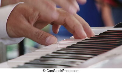 Man play music keyboard, fast tempo, shallow depth of field