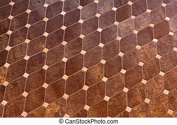 Rhomb tiles - Repetitive pattern of brown marble hard floor