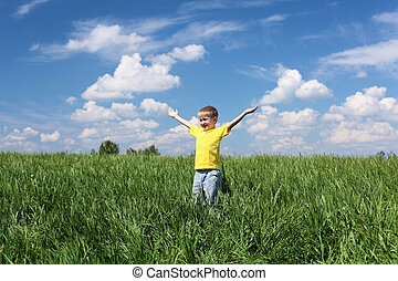little boy outdoors in sunny summer day