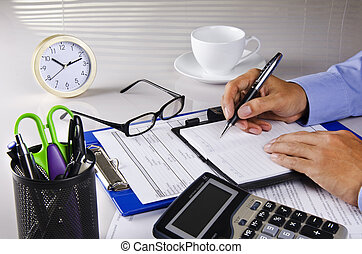 noting - a businessman is writing on his notebook
