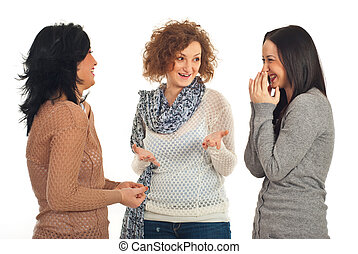 Friends talking and laughing - Happy three friends women...