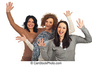 Excited three women with arms up