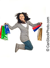Excited woman jump with shopping bags - Excited woman...