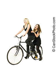 Women on a bicycle - Two women on a bicycle isolated on...