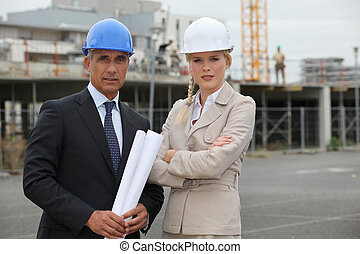 portrait of two contractors