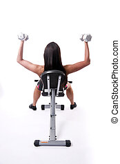 Work Out - Beautiful young woman lifts hand weights