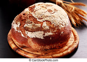 Loaf of bread - Loaf of rustic bread on black background