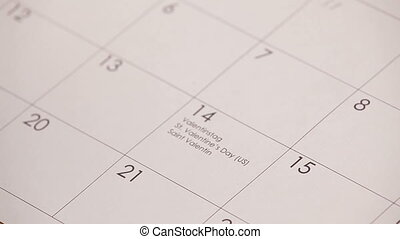 Red heart in calendar HD - Woman draws the red heart with...