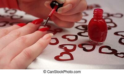 Manicure. HD - A woman makes manicure with red varnish and...