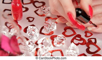 Manicure, diamonds, hearts. HD - Woman makes manicure near a...