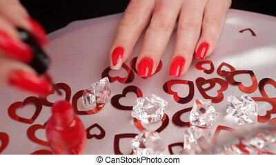 Red varnish for nails.  HD