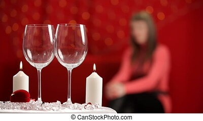 Man pours the wine in wineglasses - Man put on the table...