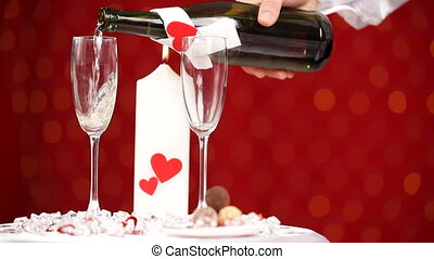 Two glasses of champagne HD - A man pours champagne into the...