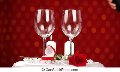 Man pours the wine in wineglasses - A man pours wine into...