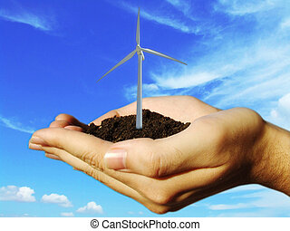 concept of wind eolic turbine in hands - Wind eolic turbine...