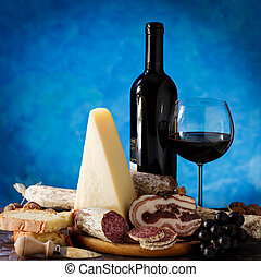 Salumi cheese, and glass of red wine - Salumi armiggiano...