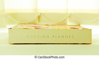 Wedding planner - A wedding planner journal on a window sill...