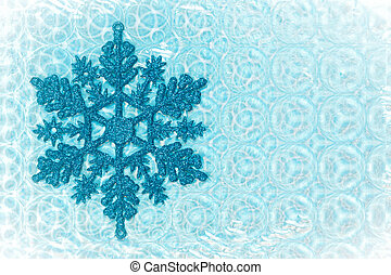 Snow flake - Nice cold toned image of a snow flake on a...