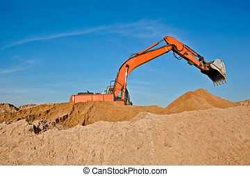 Excavator at a sandpit - Excavator at sandpit with raised...